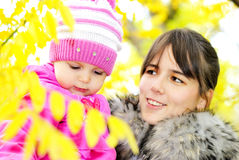 The little girl on walk with mum. The little girl  with mum Royalty Free Stock Image