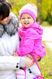 The little girl on walk with mum. The little girl  with mum Royalty Free Stock Images