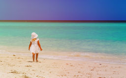 Little girl walk on sand beach Royalty Free Stock Images