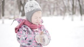 Little girl on a walk in the winter stock footage