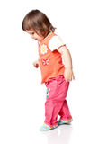 Little girl walking. Isolated on white Stock Images
