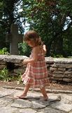Little Girl Walking. A little girl walking alone outside on a stone path at Balcic castle royalty free stock image