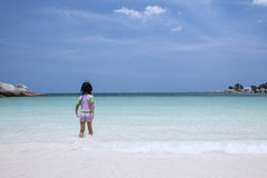 Little girl walking alone at beach Stock Photography