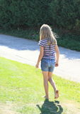 Little girl walking barefoot Royalty Free Stock Image
