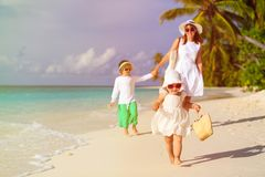 Little girl walking on the beach with family after Stock Photo