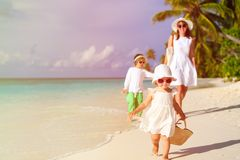 Little girl walking on the beach with family after Stock Photography