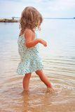 Little girl walking on the beach Royalty Free Stock Images