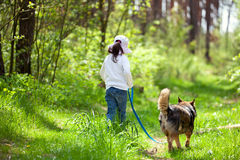 Little girl walking with dog Royalty Free Stock Photos