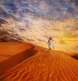 Little girl walking down the sand dune Royalty Free Stock Photos