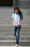 Little girl walking down  steps Stock Photo