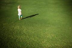 Little girl walking Stock Photo
