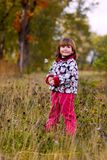 Little girl walking in forest Stock Image