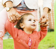 Little girl walking on green grass with mother outside, having fun, lifestyle people concept Royalty Free Stock Photo