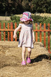 Little girl is walking on the haystack Royalty Free Stock Photography