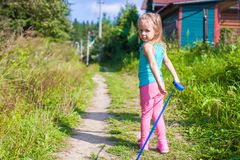 Little girl walking with her ??dog on a leash Royalty Free Stock Photography
