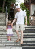Little girl walking with her father Stock Photography