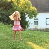 Little girl walking on meadow Stock Photo
