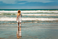 Little Girl Walking into the Ocean Royalty Free Stock Photo