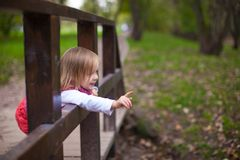Little girl walking outdoor, having fun and Stock Image