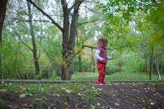 Little girl walking outdoor, having fun and Royalty Free Stock Photo