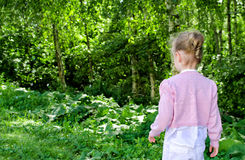 Little girl walking in the park. Stock Photo
