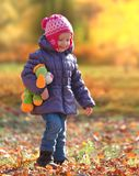Little girl walking in the park Stock Image
