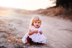 Little girl walking Stock Image