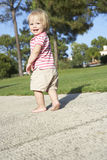Little Girl Walking In Park Royalty Free Stock Photos