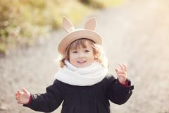 Little girl walking in the park, autumn day. Stock Photo