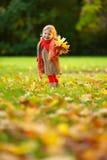 Little girl walking in the park Stock Photo