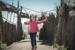 Little girl walking on a path of in a wetland stock image