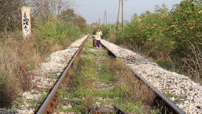 Little girl walking on railroad Royalty Free Stock Photos