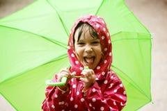 Little girl walking in the rain royalty free stock image