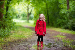 Little girl walking in the rain Royalty Free Stock Photography