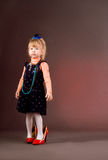 Little girl walking in red mummy's shoes Stock Photo
