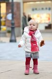 Little girl walking in shopping street Royalty Free Stock Photography