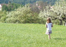 Little girl walking in spring Royalty Free Stock Photos