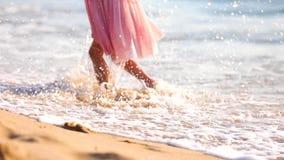 Little girl walking at sunrise on beautiful ocean beach. Happy summer vacation stock video