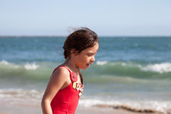 Little Girl Walking and Talking by the Ocean Stock Photos