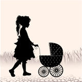 Little girl walking with toy- stroller Stock Photography