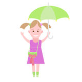 Little girl walking under an umbrella Stock Images