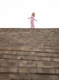 Little girl walking upstairs Stock Photo