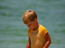 Little Girl Walking by Water Stock Photo