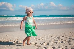 Little girl walking on white sandy beach in Mexico Royalty Free Stock Photography