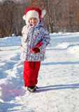 Little girl walking in a winter park Stock Photography
