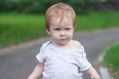 A little girl walks along the road and looks away royalty free stock image
