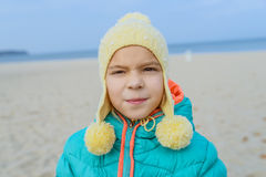 Little girl walks along shore of Baltic Sea Stock Image