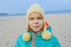 Little girl walks along shore of Baltic Sea Stock Image