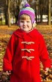 Little girl walks in autumn Stock Images