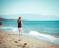 Little girl walks on the  beach Royalty Free Stock Photos